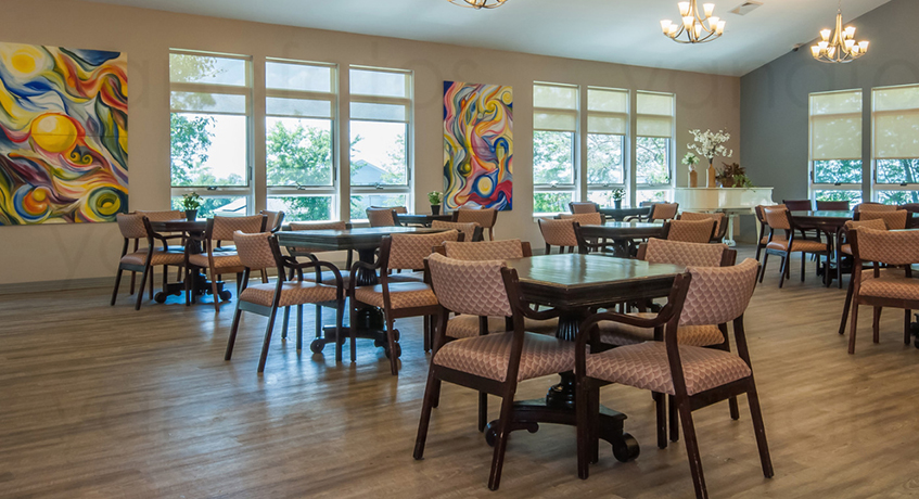 a dining room at an enhanced assisted living residence at Rosewood